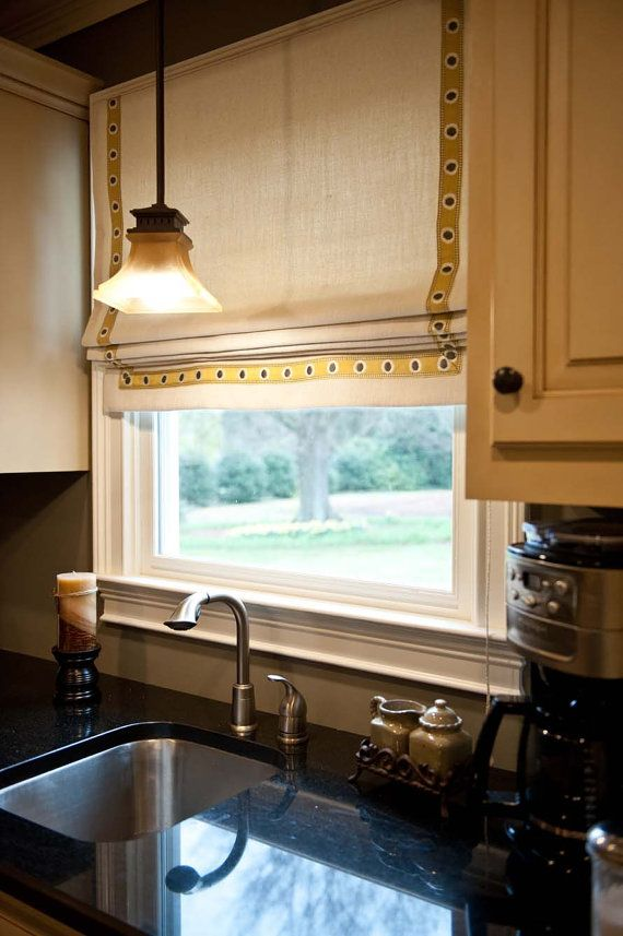 Classic flat roman shade with yellow and gray trim for kitchen window
