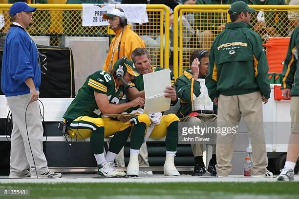 Green Bay Packers Qb Brett Favre Discussing Play With Backup Qb Aaron Green Bay Packers Green Bay Packers Football Green Bay