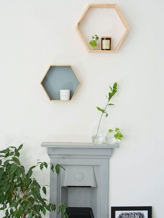 Scandinavian displays tend to be unfussy and streamlined. Get this look by hanging shelving that features a sleek, geometric shape. These hexagonal shelves boast a modern silhouette and are minimally filled to accentuate the beauty of the storage itself. The raw wood texture of the shelves further exemplifies European design.