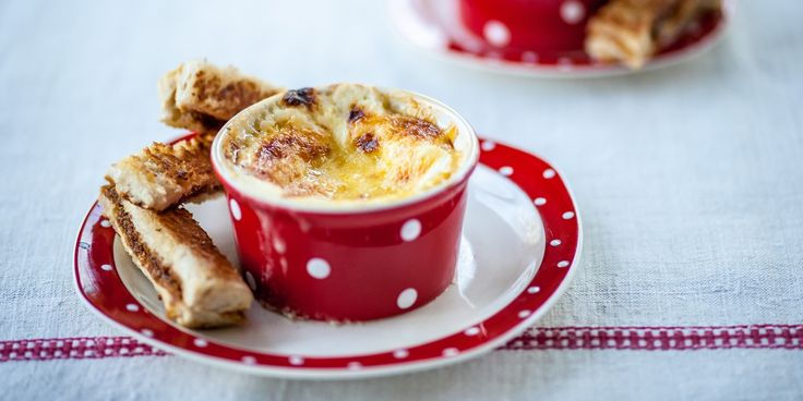 This tasty cheesy baked eggs recipe by Alyn Williams features savoury Marmite Soldiers to dip into the eggs