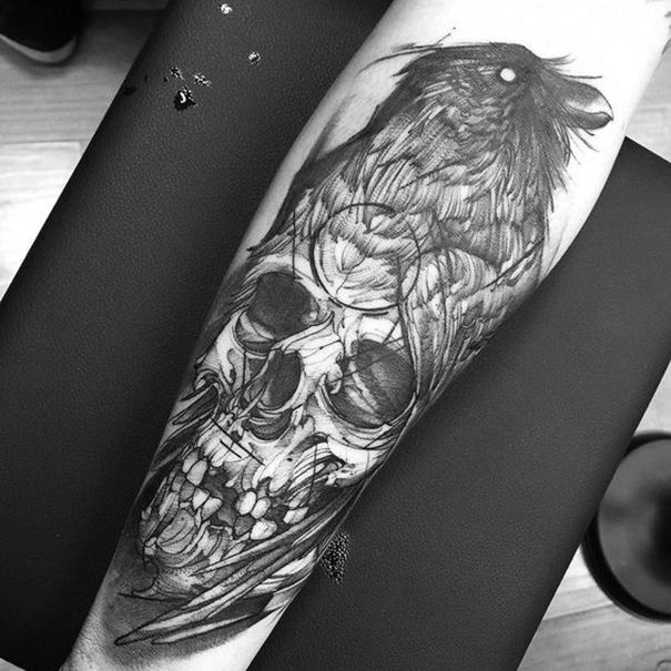crow tattoo on arm