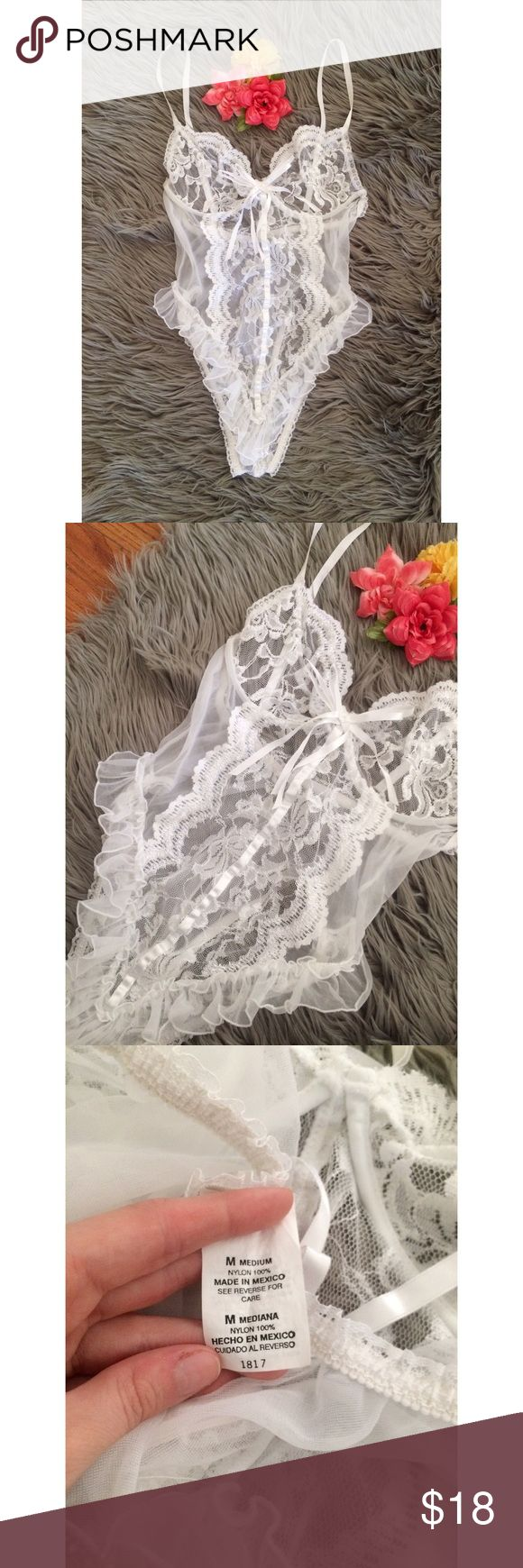 Vintage 80's White Lace Teddy Lingerie 💐 Gorgeous one of a kind vintage 80's teddy lingerie! Features delicate sheer white floral lace details all throughout complete with a special white bow on the front. Clasp closure at crotch. Back and bottom stretch to comfortably fit your body! Has underwire for support and adjustable straps! In like new condition! Size medium, could also fit a small! Bust will best fit a larger B or C cup :) Vintage Intimates & Sleepwear Chemises & Slips