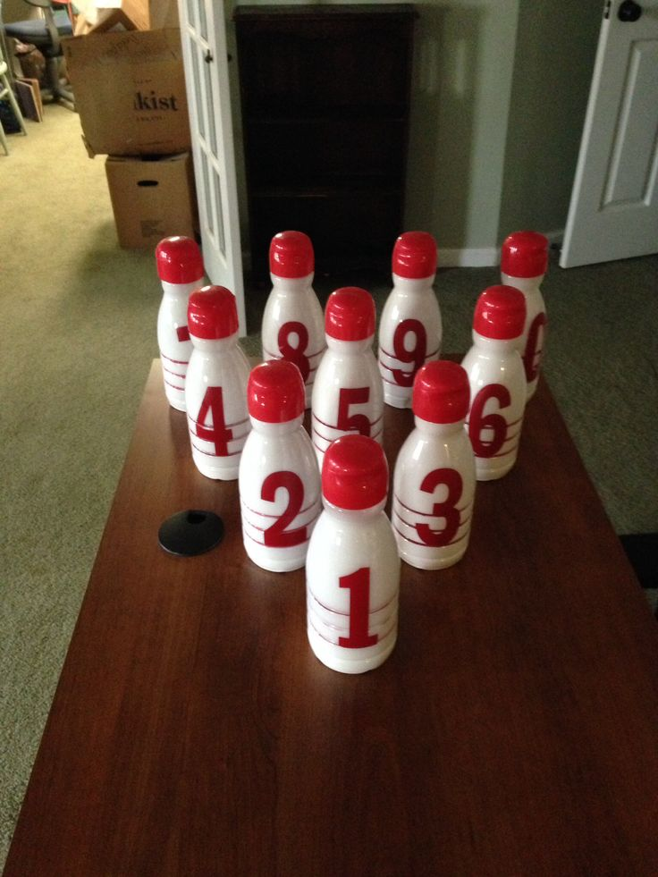 Make bowling pins, using empty coffee creamer bottles, clean-fill with white paint, swirl around pour out-I painted re lines in the groves- added red numbers for fun- fill with sand for weight, great for children's games- home- school- party's
