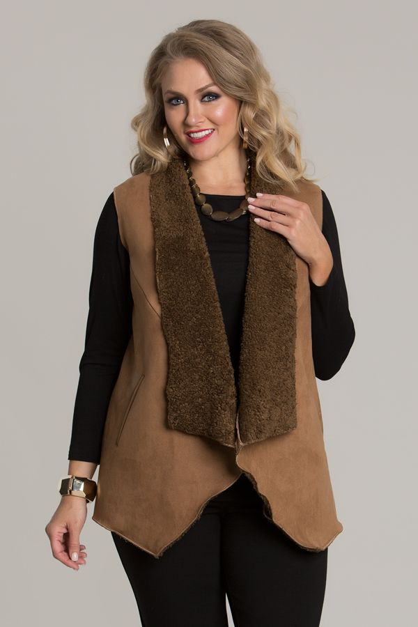 6615 Boucle Vest - This lovely warm and inviting vest, will give you an edge for the winter cold. Featuring a cascade hem at the front, bordered in faux fur and sleeveless design.