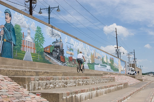 Murals on the river side of the flood wall.  This spot is packed with people eating ice cream and chatting during warm evenings.