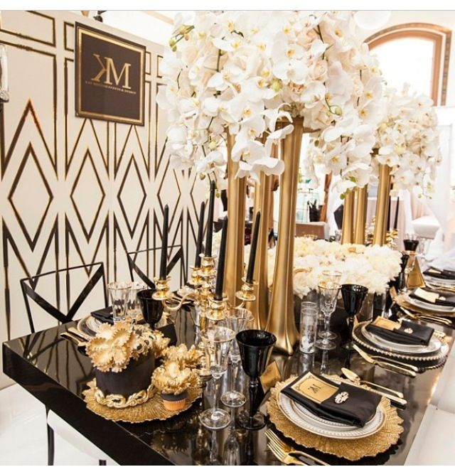 Black Gold and White - so glamorous! Love the white orchids and these beautiful gold vases