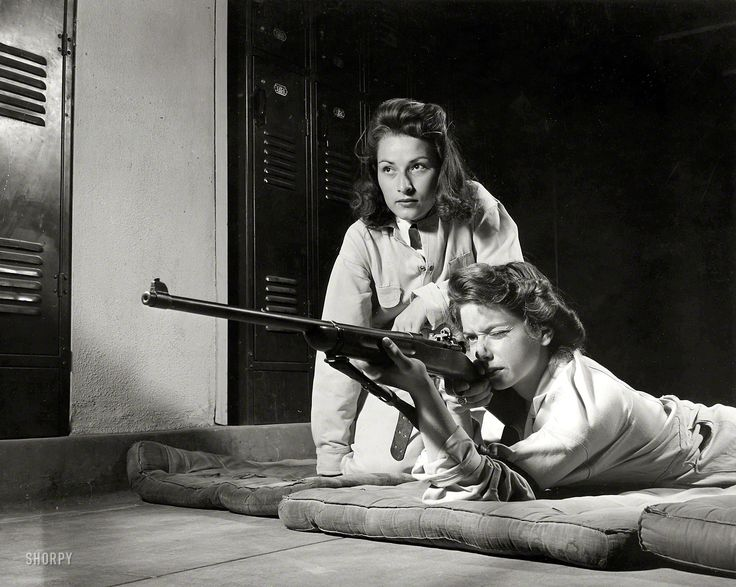 August 1942. Training in marksmanship helps girls at Roosevelt High School in Los Angeles develop into responsible women. Part of Victory Corps activities there, rifle practice encourages girls to be accurate in handling firearms. Practicing on the rifle range in the schools basement.