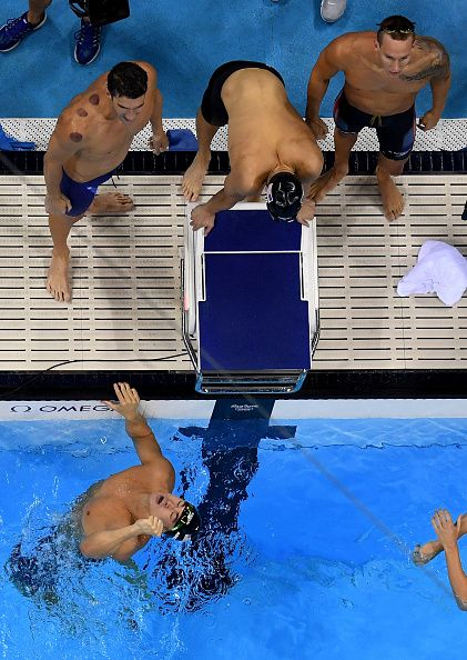 Team USA celebrate winning gold in the Final of the Men's 4 x 100m Freestyle Relay on Day 2 of the Rio 2016 Olympic Games at the Olympic…