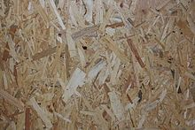Oriented strand board - great for walls in a tiny house,  low expense and durable when on the road