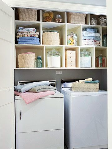 Keep your laundry center organized by giving everything a designated spot. Install cubbies at the top of the closet. Make sure some of the spaces are wide enough to hold folded clothes. Also, install the cubbies high enough for a top-loading washer to open with ease.