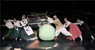 The moment in the play when Heungbu (younger brother) opens the gourd with his family.