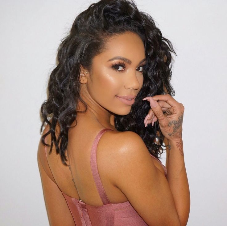 Bombshell Erica Mena wearing Lotus Lashes No. 110 from our Crystal Collection (invisible band)