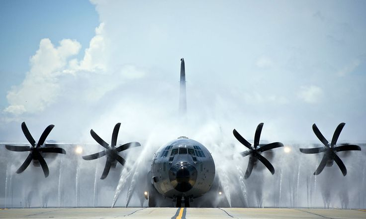 A 53rd Weather Reconnaissance Squadron WC-130 Hercules is hosed down after completing a flight over the Gulf of Mexico. The water pressure removes salt that accumulates on the aircraft when it flies