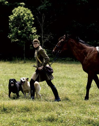 All the riders are coming, and uh oh, so are all the hunting dogs...................