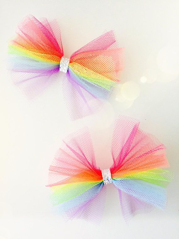 Maybe style hair in 2 puffs with these on them... Rainbow Tulle Bows  Tulle bow headbands Tulle bow hair