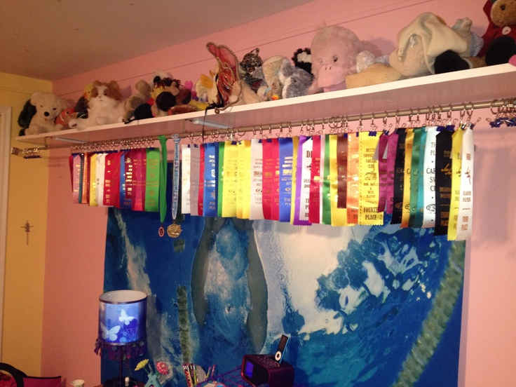 Swimming ribbon display idea... Those hooks might get costly but the curtain rod is a great idea