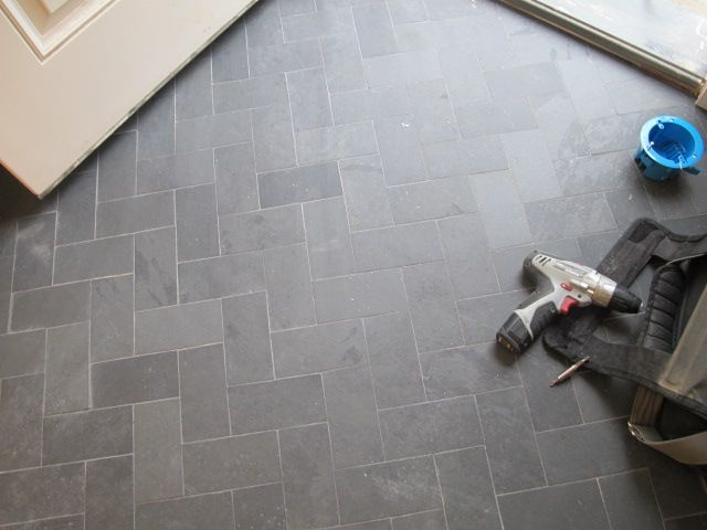 Spice up gray tile with herringbone layout - love this idea for the back hall/bathroom/laundry room floor