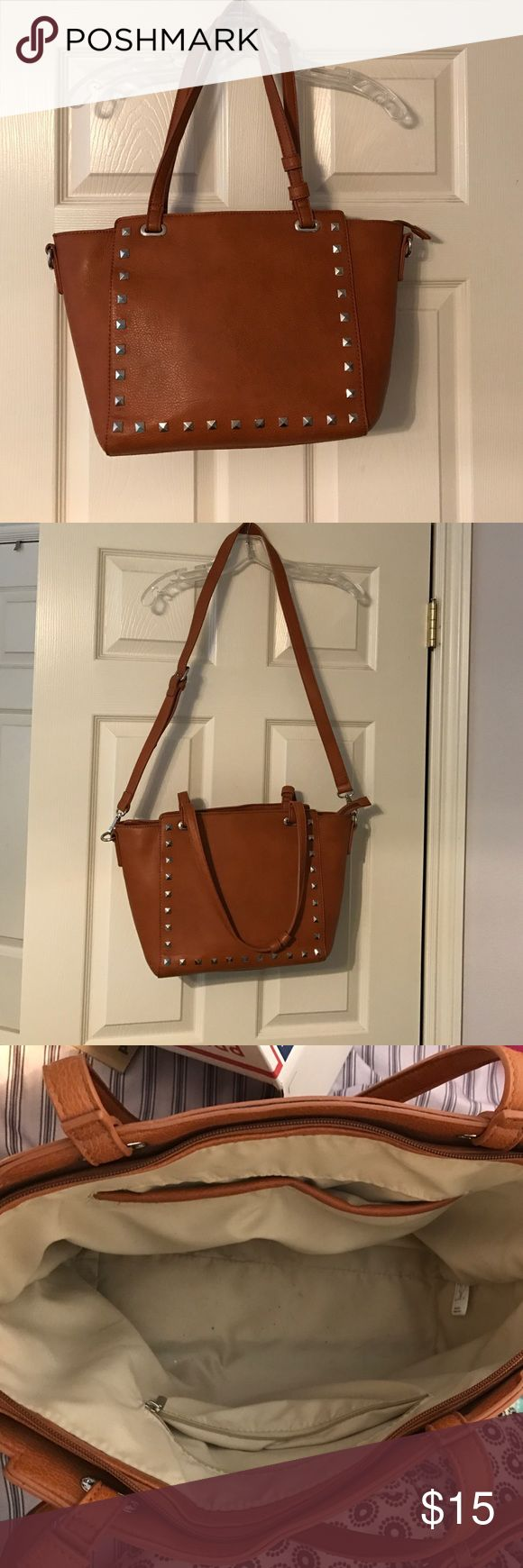 Nordstrom brown leather bag with studs From brass plum in Nordstrom. Brown/camel color leather. Silver studs. Has a cross body attachable strap. Has a zipper pocket as well as two open pockets. Zips up at the top. There is a small black dot stain on the back of the purse! Lightly used. Other than the spots it's in perfect condition. Price negotiable😘😍 bp Bags Crossbody Bags