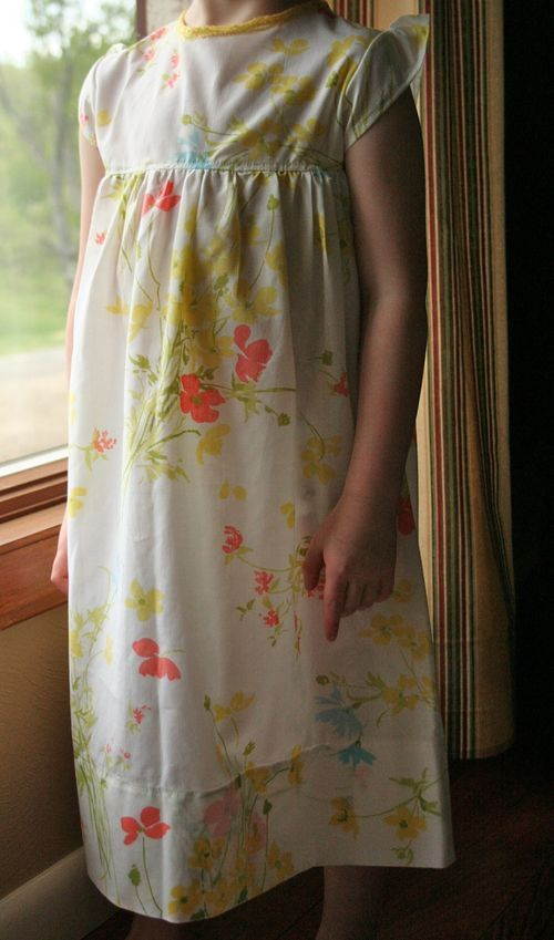 Here it is - a tutorial for a girls nightgown - a free pattern for a 4T is included, but this is a really loose tutorial that assumes many basic techniques (pattern drafting from existing clothing for sizes other than 4T, gathering, finishing seams)