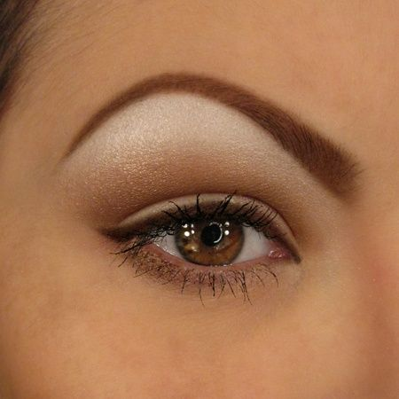 small, understated cateye in brown liner with crease emphasis