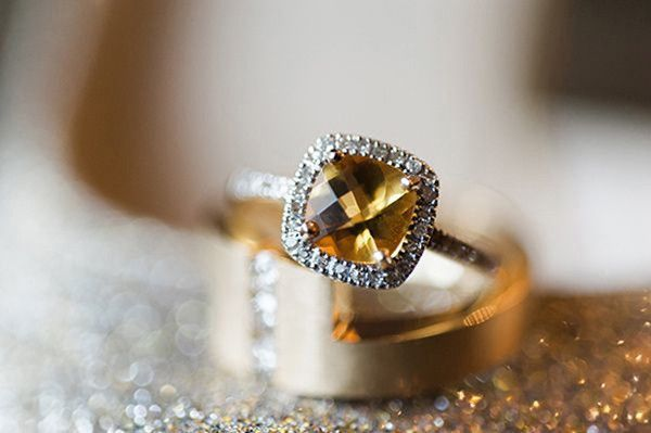 citrine engagement ring in diamond covered halo setting