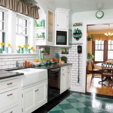 Dark gray grout makes the subway tile pop and plays off the polished granite counters. Every detail was carefully chosen, from the dial tele...