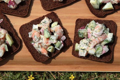 Open-Faced Shrimp Salad Sandwich Recipe_This light yet satisfying shrimp salad is loaded with crunchy veggies and bright herbs. It can be enjoyed on its own in a sandwich, over a bed of greens, or on a Crispy Rye Cracker.