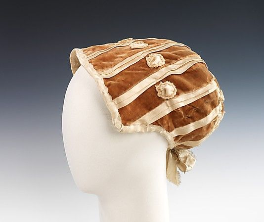 This 1802 silk American bonnet typifies a classic high-style shape of the period. The rich velvet and silk ribbon used would perfectly suit a formal evening ensemble, as opposed to the lighter cottons and linens frequently used in day bonnets and caps.