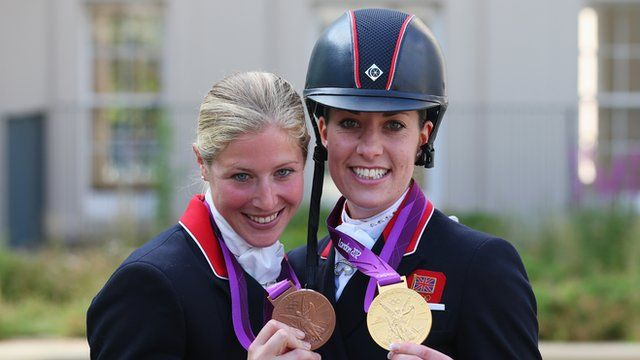 "Charlotte Dujardin and Laura Bechtolsheimer - 3rd Golden Woman from Day 13 - Charlotte Dujardin won Britain's second dressage gold medal of the Olympics as the host nation's equestrian team finished London 2012 with three titles.  ""I wanted to enjoy it, go out and not regret anything,"" said Dujardin, who also helped Britain to team victory in Greenwich Park on Tuesday.  Dujardin beat a huge score from Dutch rider Adelinde Cornelissen while Laura Bechtolsheimer took bronze for GB."