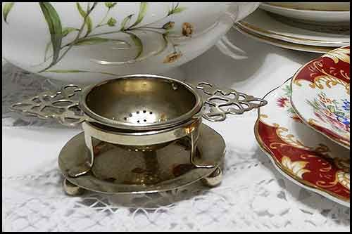 Tea strainers for hire and vintage china cup sets
