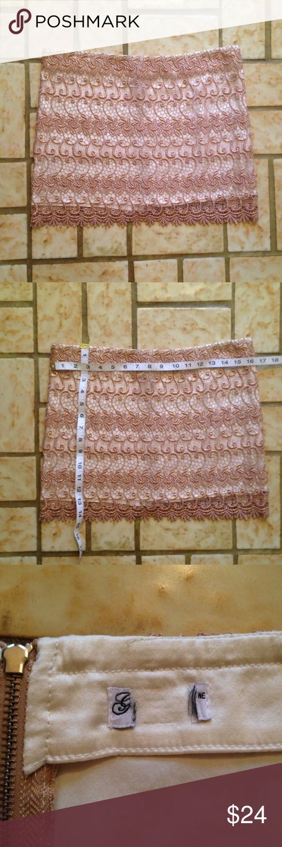 Metallic Gold Lace Silk Lined Mini Skirt This skirt is beautiful! It is rose gold in person with cream, silk lining. It zips in the back and fits like a medium, though the tag is cut out.  Measurements can be seen in the pictures. Please let me know if you have any questions! Bundle with my other items for a good deal. Thank you for looking! Skirts Mini