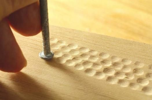 Adding texture to wood with tools | Use a round nail head (chuck the nail in a drill, pull the trigger and smooth the nail head with 120 to 220 grit sandpaper) and tap lightly with mallet to create smooth, concave dimples. Works best on softer woods