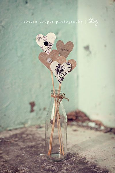 recycled bottle, wood skewers cut at different heights, scrapbook paper shape to fit the occasion.