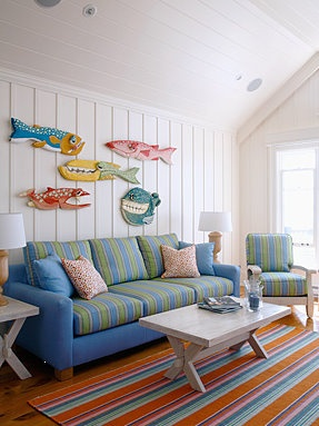 Beach house perfection! The stripes are so cool & crisp. The art reminds me of my friend Craig Gurganus' - he does wonderful whimsical things like this.