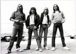 Back in 1962 a group called The Spectres founded by Francis Rossi and Alan Lancaster. In 1967 the group became Staus Quo with Rick Parfitt of course.  In 1970 there first UK hit in the 1970s was Down The Dustpipe reaching No. 12 which was followed by a non top twenty hit called In My Chair. http://hits-of-the-70s.blogspot.com/2014/11/in-1970s-status-quo.html