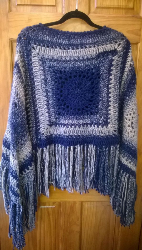 Easy crochet poncho, created by making 4 large crochet granny squares with some simple shaping around the neck and adding lots of lovely tassels. We used Stylecraft Ombre Aran weight yarn so we didn't have to keep changing colours, just keep working from the ball, generous fit for most sizes and a great cover up for those chilly days but when wearing a coat is just a bit too much http://www.disswoolandcrafts.co.uk/?blog=blogs/archive/tag/stylecraft/index.aspx