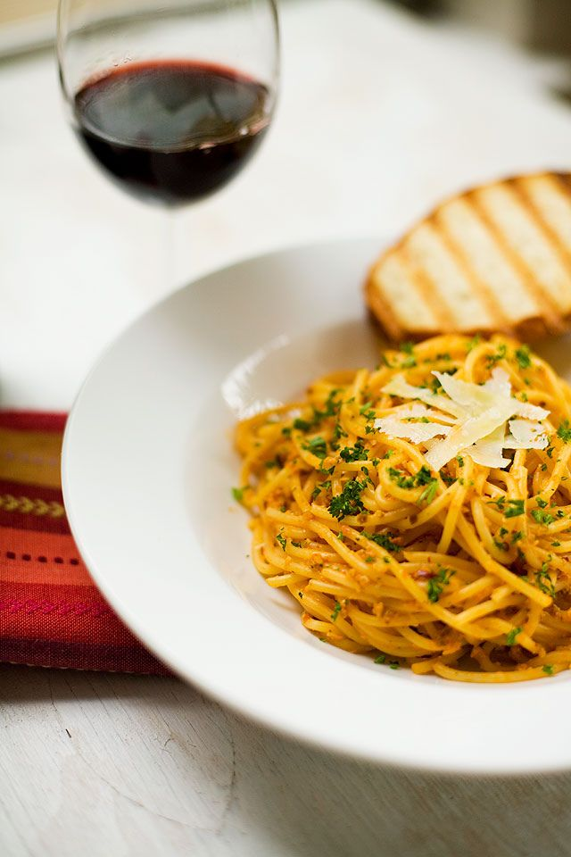 Pasta in creamy tomato sauce with pumpkin seeds