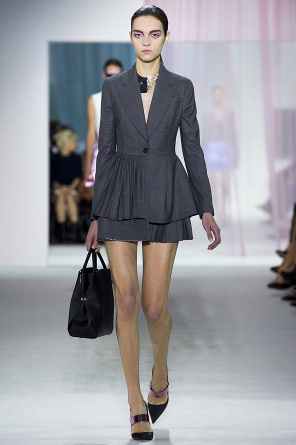 Christian Dior encorporates asymmetric pleating into a tailored jacket and skirt ensemble in his S/S13 collection