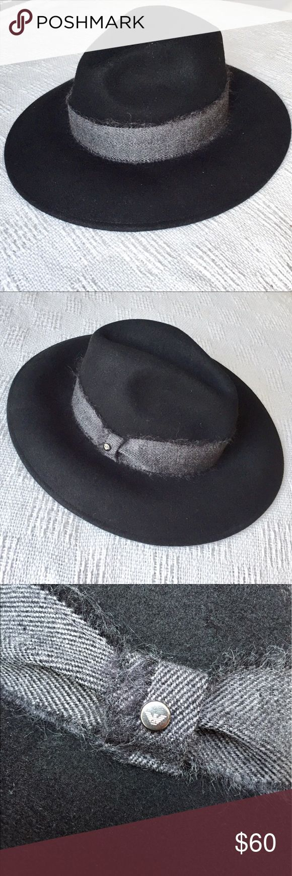 Emporia Armani Black hat with grey detail Stylish Emporio Armani black hat with freyed detail around the rim. Emporio button on side and cool look any season. Wool fabric, Made in Italy. Original. Emporio Armani Accessories Hats