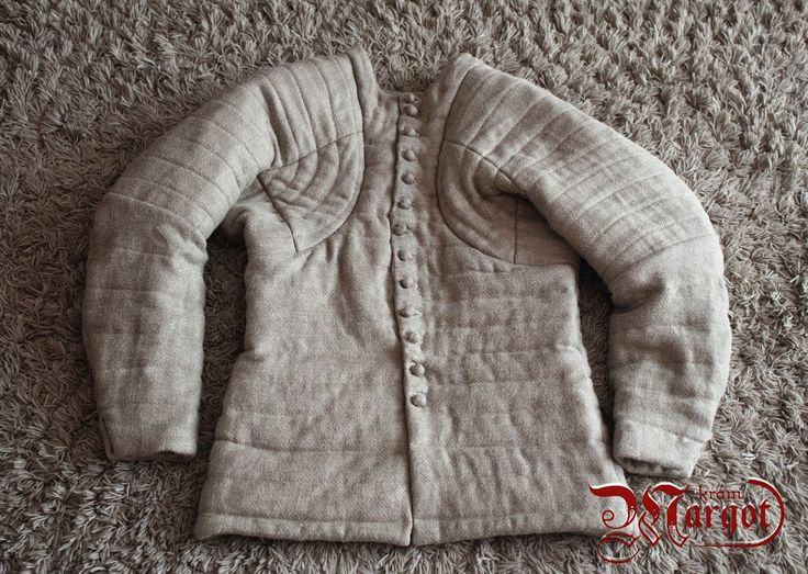 A custom-made aketon based on the fourteenth-century pourpoint of Charles de Blois , made of 100% linen. Additional layers on back and shoulders provide additional protection.