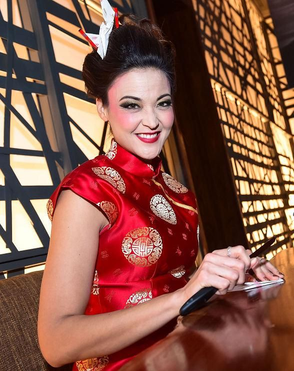 Morimoto Las Vegas Grand Opening Takes Over MGM Grand with Lion Parade, 100-Foot Maki Roll and More (Pictured: Jenni Lee folds paper cranes – Photo credit: MGM Resorts International).