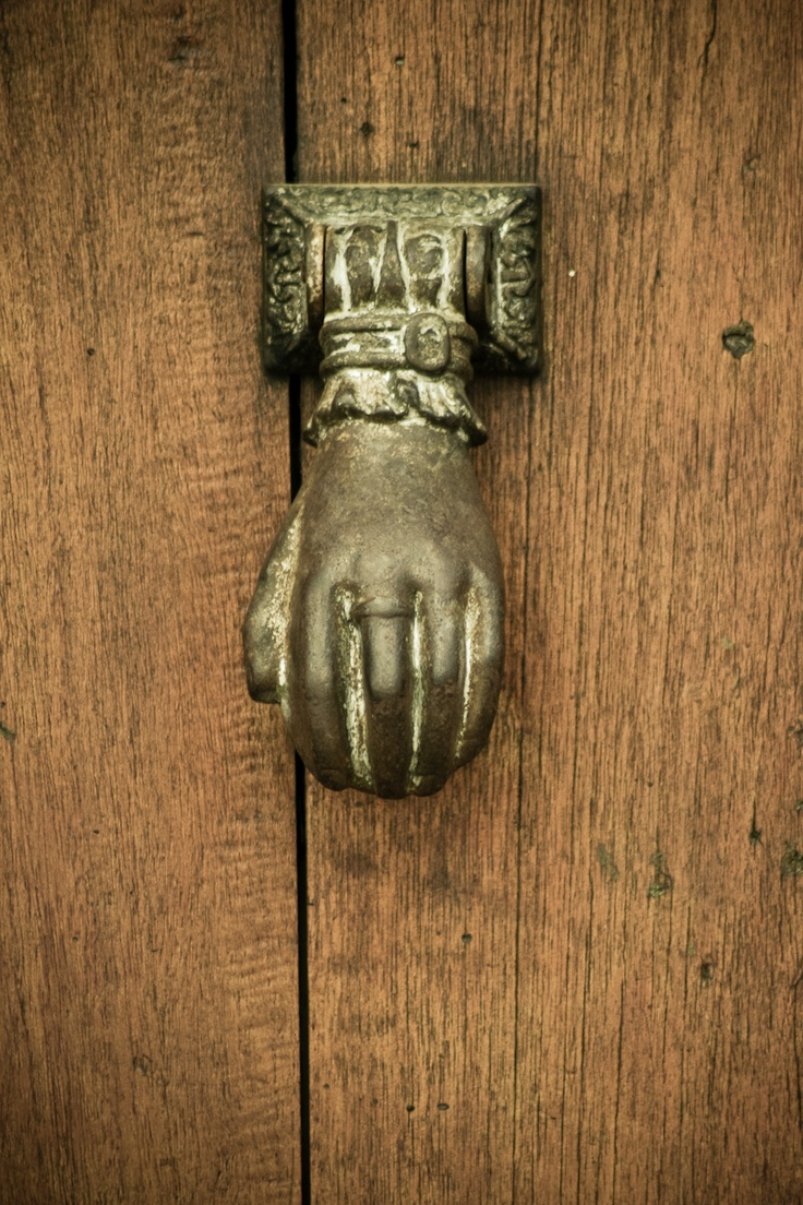 A Barichara door detail, this hand is to knock on it. Barichara, Colombia.