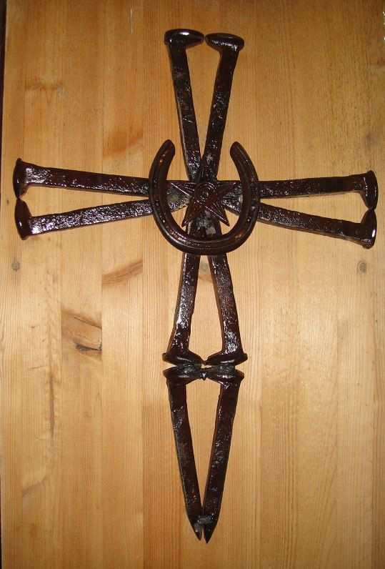 Cross made out of railroad spikes a horseshoe by for Where to buy horseshoes for crafts