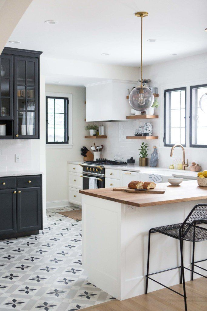 Maybe you're designing your dream kitchen and you can't decide whether you want upper cabinets or open shelving, white cabinets or dark ones, butcherblock countertops or marble. Well, what if you didn't have to decide at all? Blogger Kate Arends, of Wit & Delight, created a kitchen that masterfully mixes all kinds of opposites. Here are five ideas worth stealing from this lovely space.