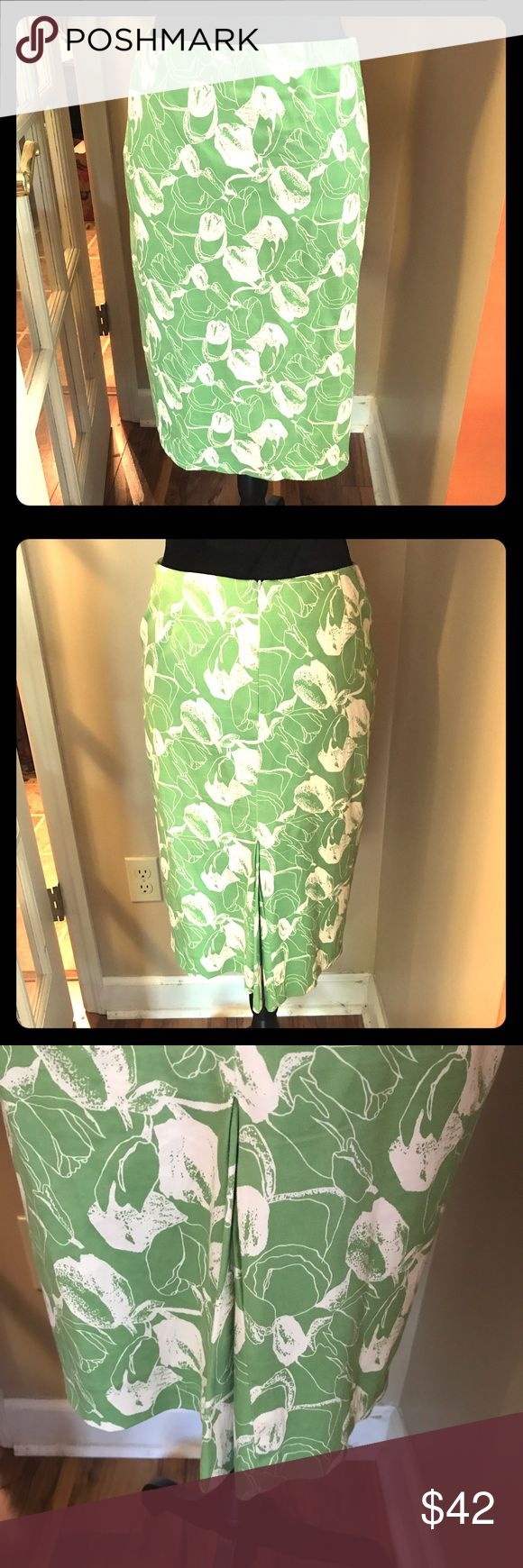 """Helen Wang New York skirt sz small Helen Wang New York skirt sz 2... gorgeous green & cream skirt ... back hidden zipper.. back kick pleat... unlined cotton & stretch.. Sz 2 but measures 14"""" across waist so depends so sue depends on where you want the waist to sit... if you wear a size 4 or 6 this is perfect.... length 23"""" in my opinion this skirt runs large for a size 2 ... Has been gently worn once... ' though tag says dry clean only I washed in cold water & drip dried & it is still…"""