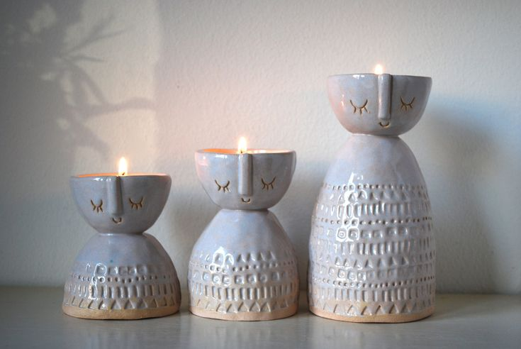 lady ceramic candle holders or in white glaze, via Etsy.