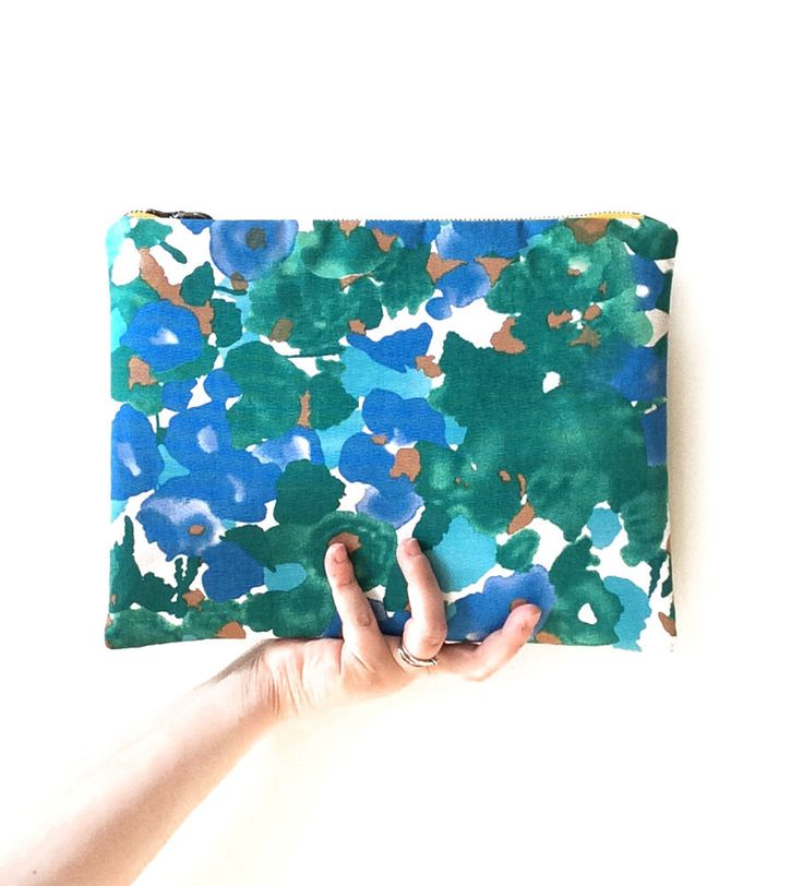 A personal favorite from my Etsy shop https://www.etsy.com/listing/230153418/floral-clutch-bag-handmade-purse-large