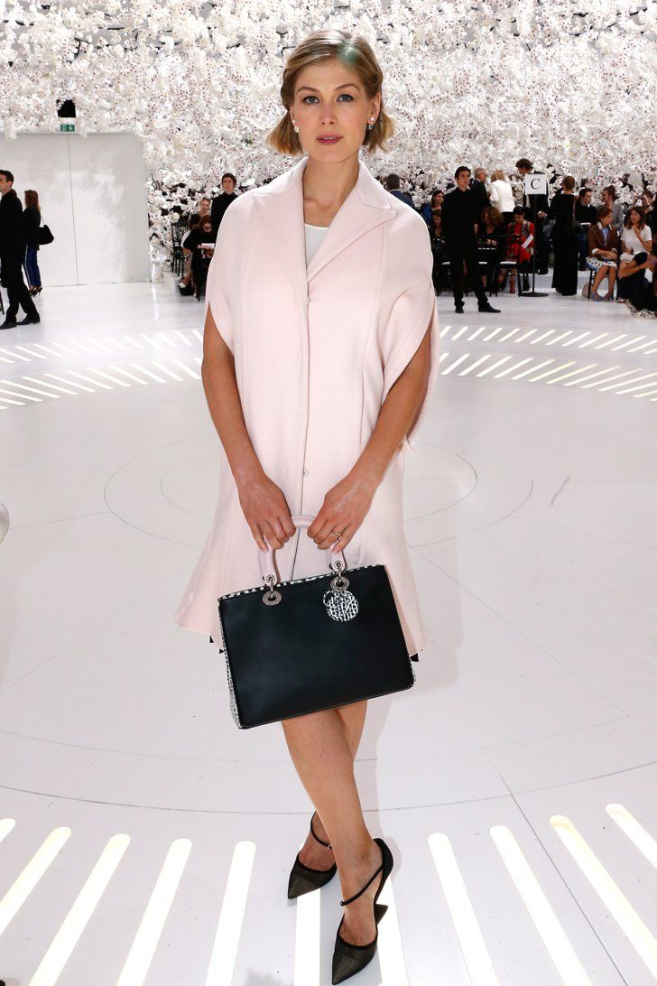 Pin for Later: From Bond Girl to Gone Girl: Rosamund Pike's Red Carpet Evolution Rosamund Pike Making a front-row appearance at the Christian Dior Haute Couture show in July 2014, Rosamund was dressed head to toe in the brand.