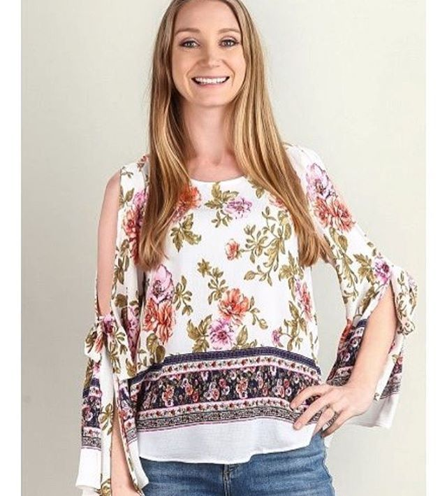 I know it is snowing  in WNY but this top is perfect for spring!   Look forward to the nicer weather with breezy open sleeves.