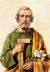St. Joseph the Workman depicted holding his emblem, the lily, which denotes purity, and a carpenter's square.